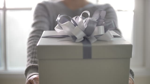 woman hands holding a gift box - wrapped stock videos & royalty-free footage