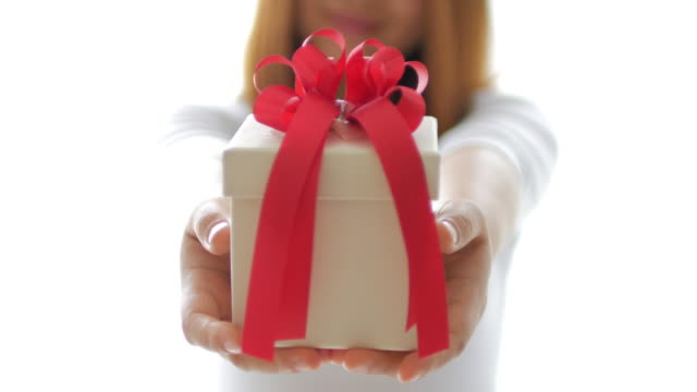 Woman hands holding a gift box