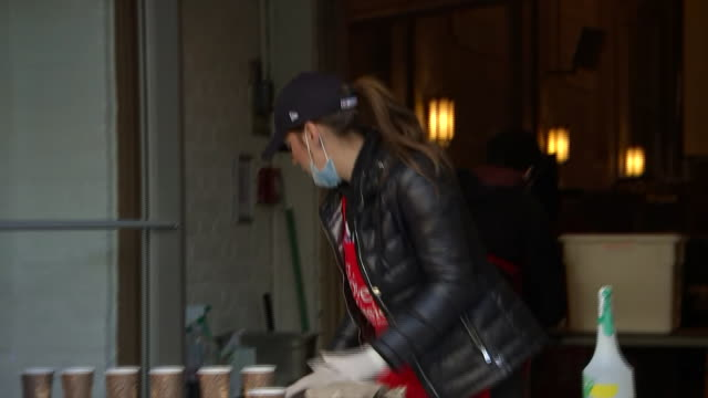 a woman hands out coffee and food to the homeless during the covid19 pandemic at the bowery mission in new york city - healthcare and medicine or illness or food and drink or fitness or exercise or wellbeing stock videos & royalty-free footage