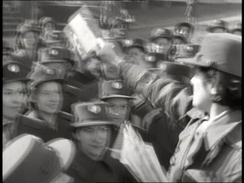 a woman hands out mail to a crowd of wacs in uniform - womens army corps stock videos & royalty-free footage