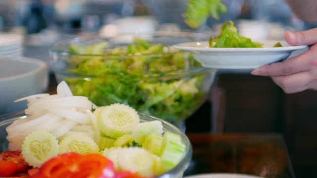 woman hands selecting vegetable from salad bar for healthy food - food bar stock videos and b-roll footage