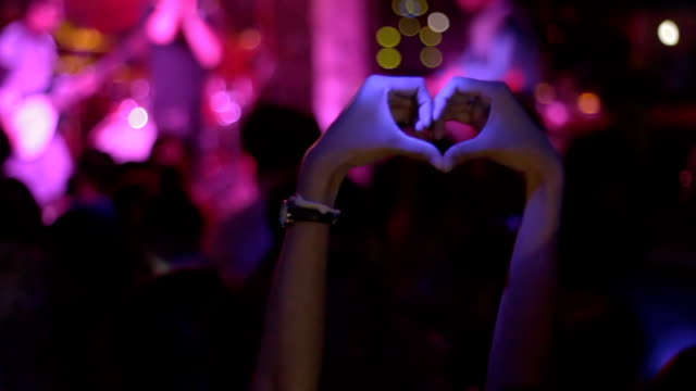 woman hands showing heart shape in concert - street party stock videos & royalty-free footage