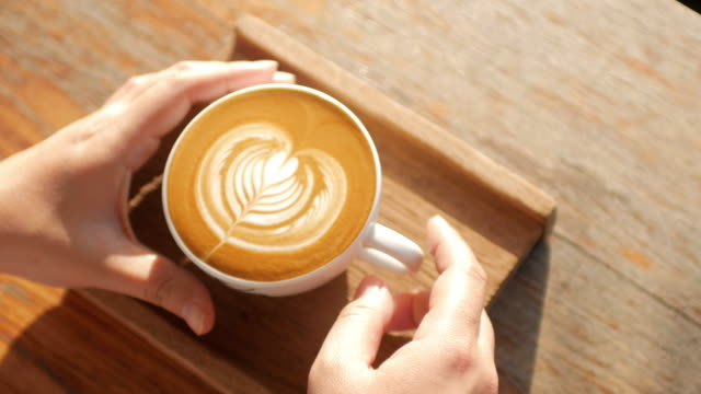 woman hands take a coffee cup at coffee cafe - froth art stock videos and b-roll footage