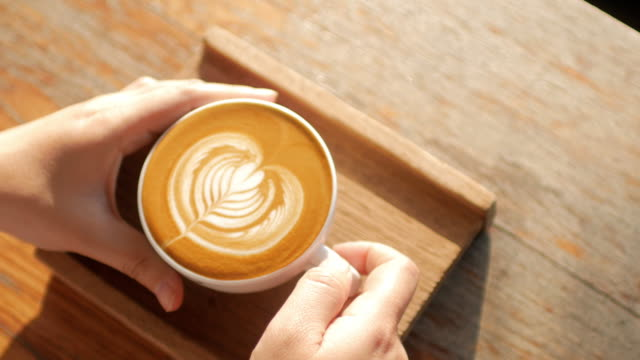 woman hands take a coffee on wooden table at coffee cafe - coffee cup stock videos & royalty-free footage