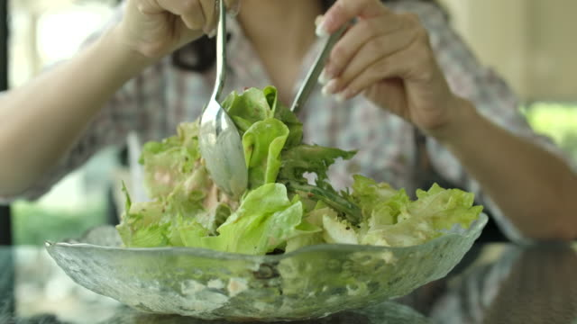 slo mo woman hands take a salad , healthy food - leaf vegetable stock videos & royalty-free footage
