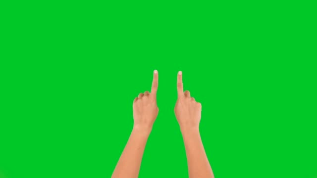 4k woman hands touchscreen zoom in and out on green screen - hand sign stock videos & royalty-free footage