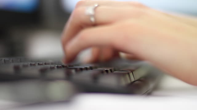 Woman hands typing in a computer