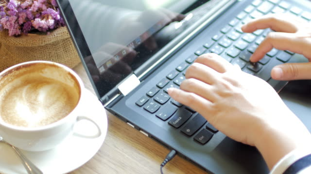 Woman Hands typing on Laptop keyboard with dolly shot movement
