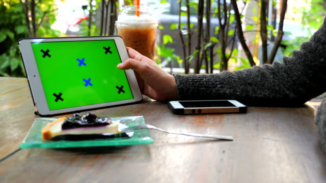 Woman hands using chroma key Tablet swipe gestures
