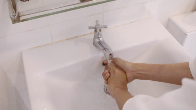 4K CU : Woman Hands washing hands in bathroom, close-up of hands