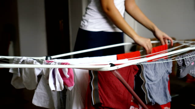 woman hanging clothes - washing line stock videos & royalty-free footage