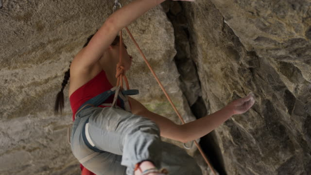 woman hanging from rope inside cave inspecting rock ceiling / american fork canyon, utah, united states - american fork canyon stock videos and b-roll footage