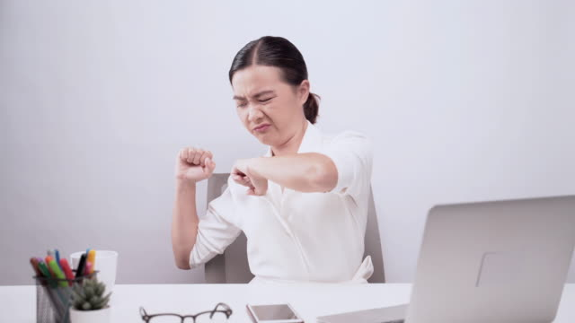 woman has body pain isolated over white background: office syndrome concept - waist stock videos & royalty-free footage