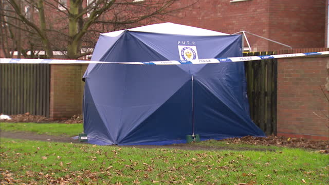 a woman has died and a man is critical in hospital after being found with stab wounds at a house in wolverhampton police were called to reports of... - west midlands stock-videos und b-roll-filmmaterial