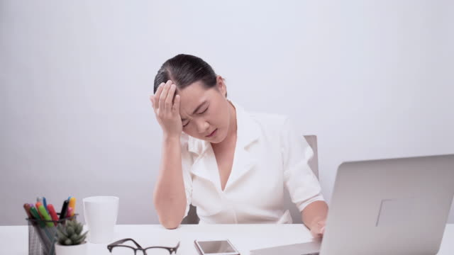 woman has headache at office isolated over white background - dizzy stock videos & royalty-free footage