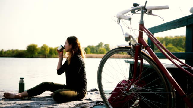woman has picnic near the lake - picnic stock videos and b-roll footage