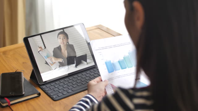 woman have video conference with her manager at home - video call stock videos & royalty-free footage