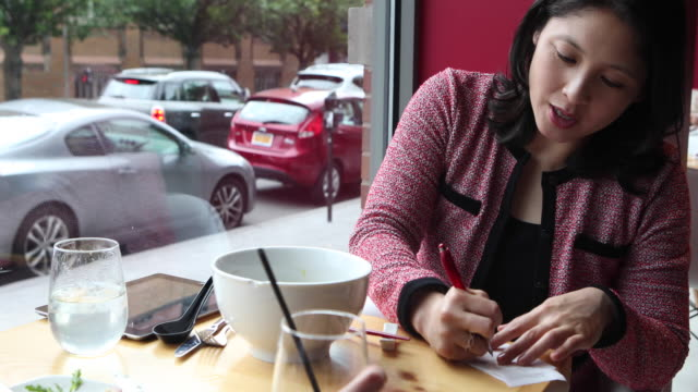 woman having a business lunch - signature stock videos & royalty-free footage