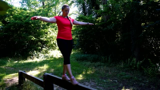 stockvideo's en b-roll-footage met woman having a fitness workout outdoor. - one mid adult woman only