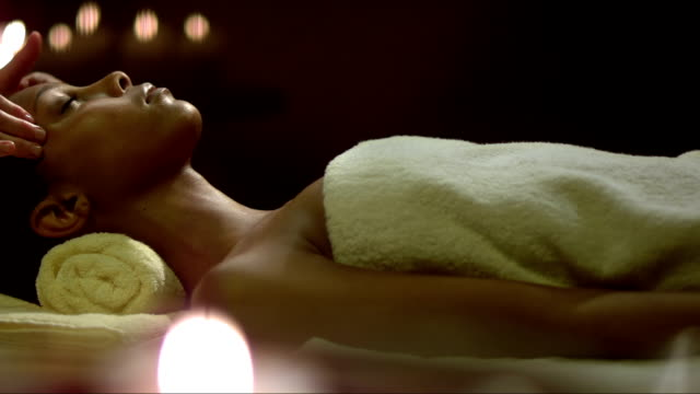 woman having a head massage - spa treatment stock videos & royalty-free footage
