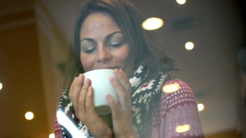woman having a tea or coffee on snowy day. - warm clothing stock videos & royalty-free footage