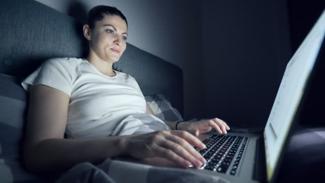 Woman having an online conversation.