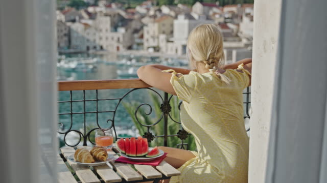 slo mo woman having breakfast on a balcony with an ocean view - mediterranean sea stock videos & royalty-free footage