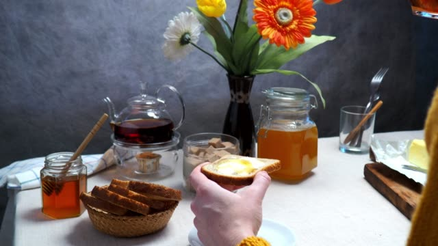 woman having breakfast with toasts and honey - teapot stock videos & royalty-free footage