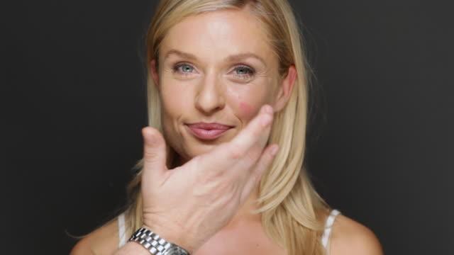 cu woman having creme blush put on / copenhagen, denmark - sich verschönern stock-videos und b-roll-filmmaterial