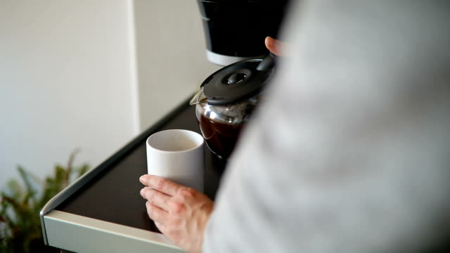 Woman having cup of coffee after shower