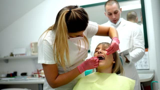 woman having dental exam - protective mask workwear stock videos and b-roll footage