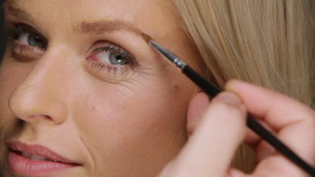 ECU Woman having eyebrows accentuated / Copenhagen, Denmark
