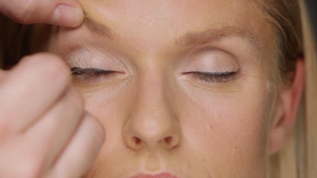 ECU Woman having eyeliner put on / Copenhagen, Denmark
