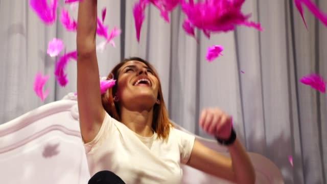 woman having fun at bed - penna video stock e b–roll