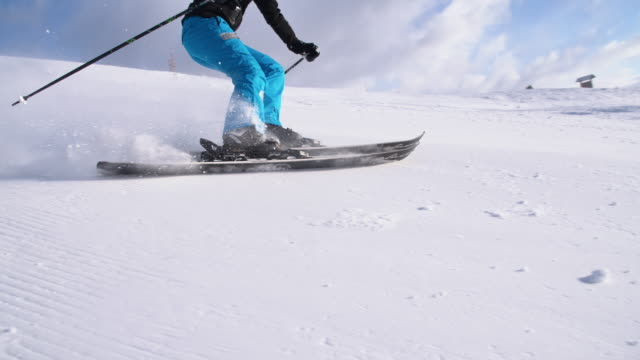 SLO MO Woman having fun carving down ski slope