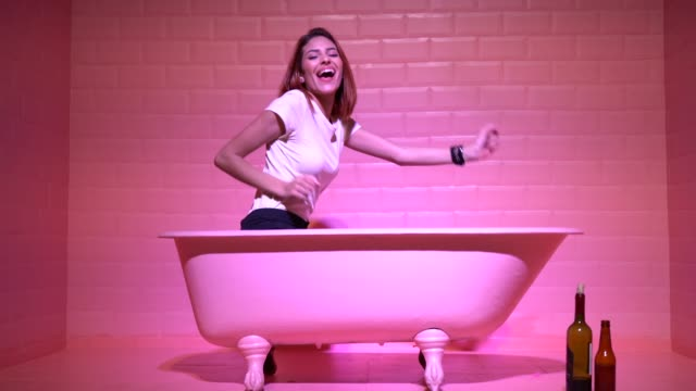 woman having fun in the pink bathtube - fashionable stock videos & royalty-free footage