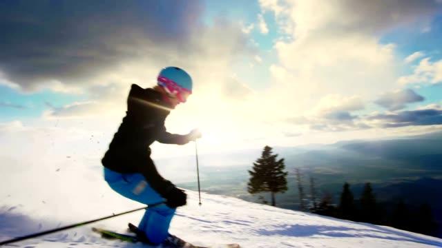 SLO MO Woman having fun skiing down ski slope