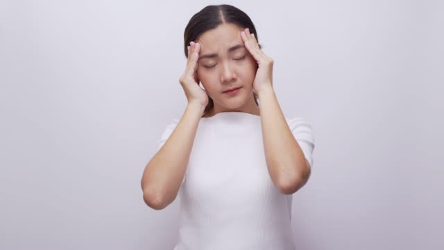woman having headache on isolated white background 4k - cramp stock videos & royalty-free footage