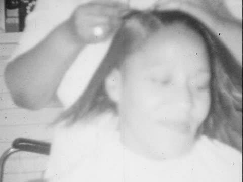 1950 MONTAGE B/W Woman having her hair done at 'Martin's Beauty Nook' hair salon/ Greenwood, Tulsa, Oklahoma, USA