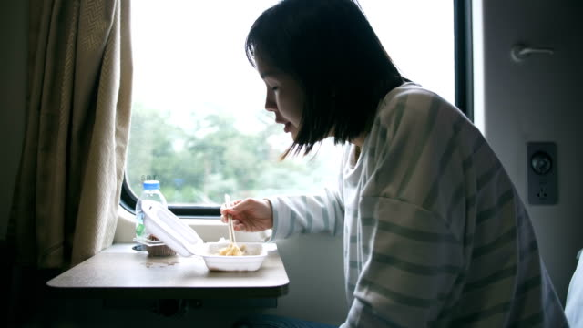 woman having her morning breakfast on the train in thailand - noodles stock videos & royalty-free footage