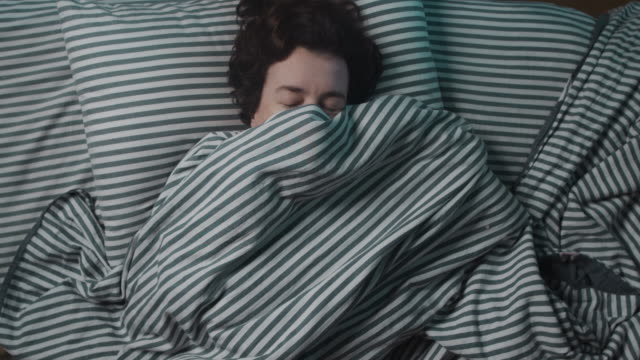 woman having insomnia is covering with a blanket - blanket stock videos & royalty-free footage