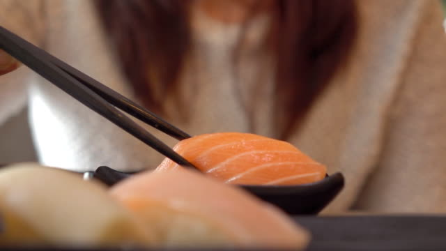 woman having japanese sushi in restauran - wasabi stock videos and b-roll footage