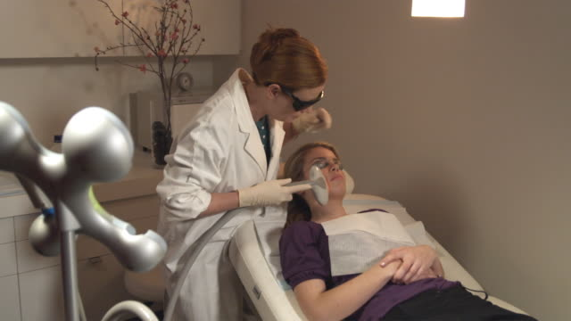 MS, Woman having laser skin treatment, Sydney, Australia