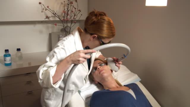ms, woman having laser skin treatment, sydney, australia - self improvement stock videos & royalty-free footage