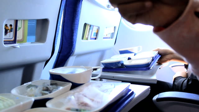 Woman Having lunch in airplane