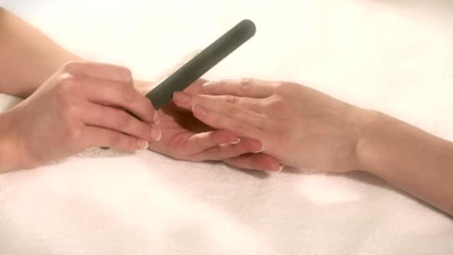 woman having manicure in beauty salon - manicure stock videos & royalty-free footage