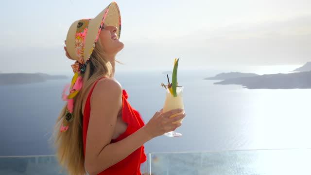 woman having pina colada - santorini stock videos and b-roll footage
