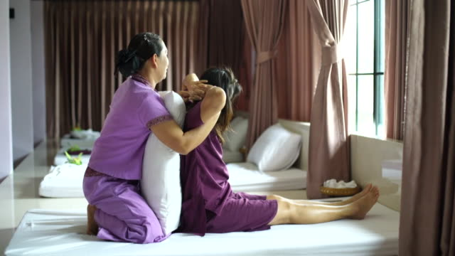 woman having relaxing with thai massage - thai culture stock videos & royalty-free footage