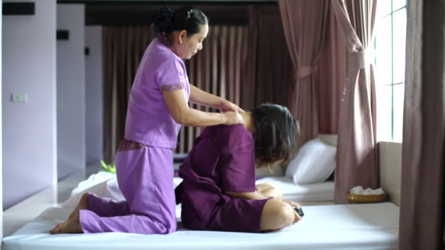 woman having relaxing with thai massage - lymphatic system stock videos & royalty-free footage
