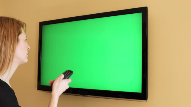 woman having remote control problems - flat screen stock videos & royalty-free footage